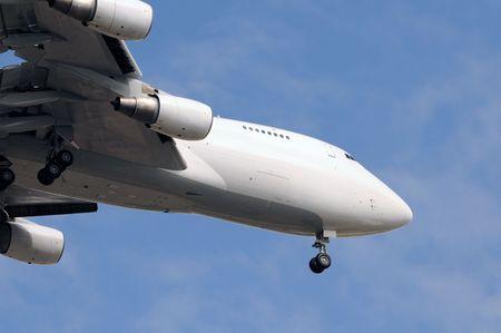 Heavy jumbo jet descending for landing photo
