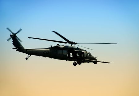 airborne vehicle: US Army helicopter in early morning