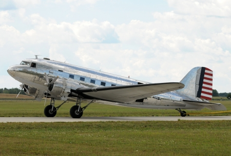 turboprop: Vintage silver colored turboprop airplane side view
