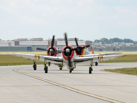 Three propeller airplanes taxxing for takeoff photo