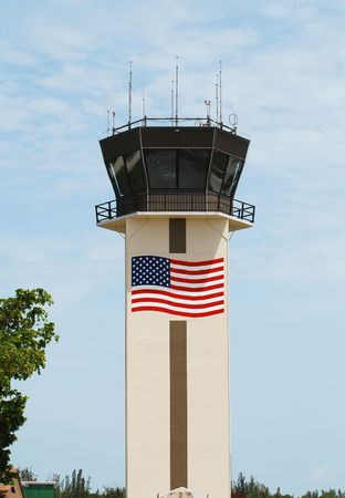 Airport control tower with painter American flag Imagens