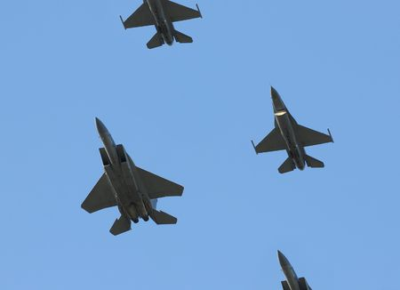 Formation of military airplanes passing overhead