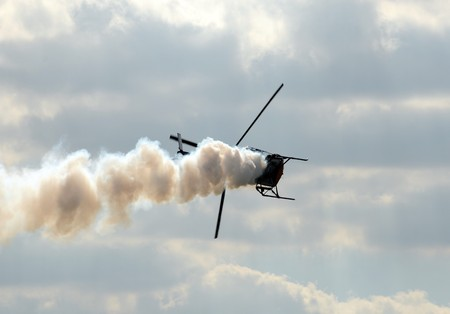 Light helicopter with smoke making emergency landing