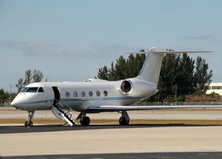 Luxury jet airplane welcoming passengers with open door