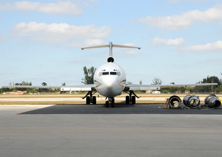 Front view of passenger jet airplane and engine parts Stock Photo