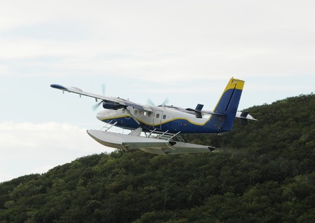Modern flying boat departing into the morning sky Stock Photo