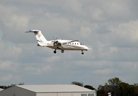 turboprop: Turboprop regional airplane arriving at destination