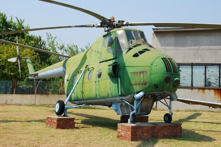 cold war: COld War era military helicopter in green color