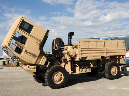 exposed: Army truck with exposed cabin and engine Stock Photo