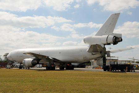 dismantled: Old passenger jet being dismantled for parts