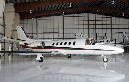 Luxury private jet parked in a hangar