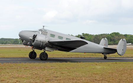 turboprop: Vintage turboprop airplane in gray color taxiing