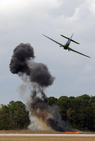 bombardment: World War II era airplane dropping bombs
