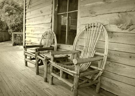 Old fashioned frontier home with porch and chairs