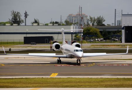 Luxury private jet taxiing on a tarmac Stock Photo - 4912768