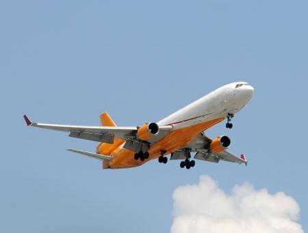 Wide body cargo jet airplane before landing