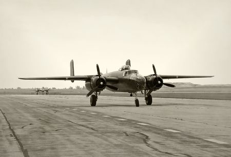 wartime: Two old wartime bomber taxiing on a runway Stock Photo