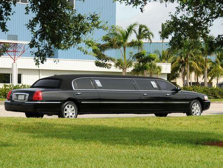 Luxury black limousine awaiting customers Stock Photo