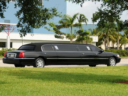 limo: Luxury black limousine awaiting customers Stock Photo