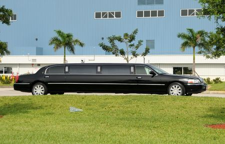 Black stretched limo awaiting passengers photo