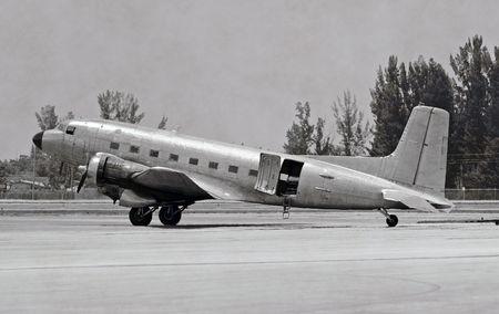 World War II era propeller airplane on the round photo