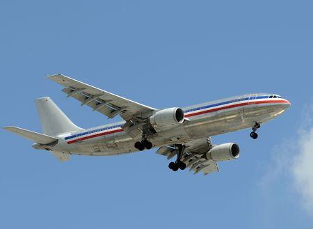 Passenger jet airplane flying overhead photo