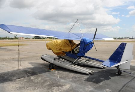 airplane ultralight: Private ultralight airplane parked on a tarmac