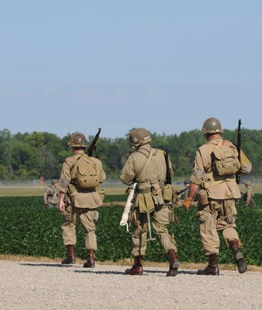 World War II era soldiers marching