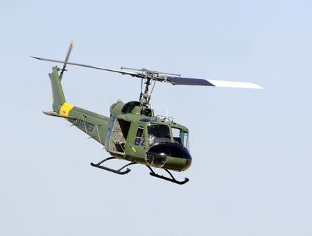 Vietnam War era Huey helicopter hoveting