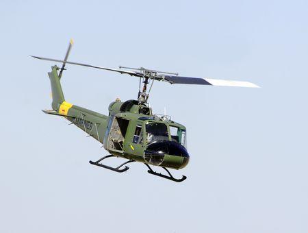 Vietnam War era Huey helicopter hoveting