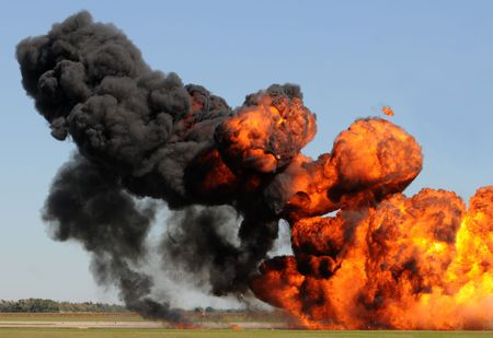 Giant outdoor explosion with fire and black smoke