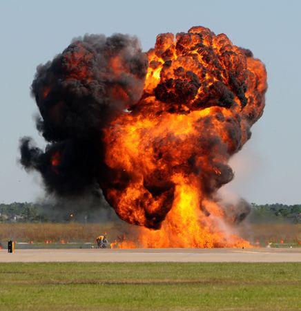 detonation: Giant fireball with smoke and flames outdoors
