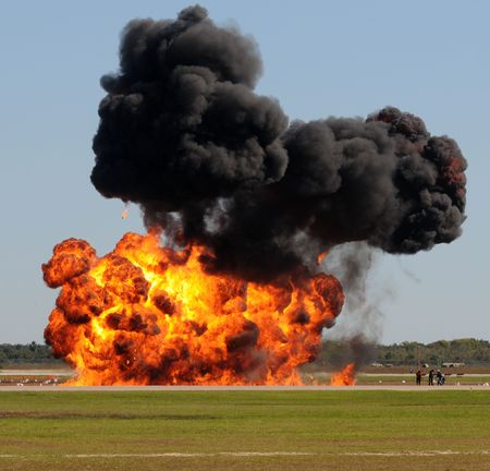Giant outdoors explosion with fire and black smoke