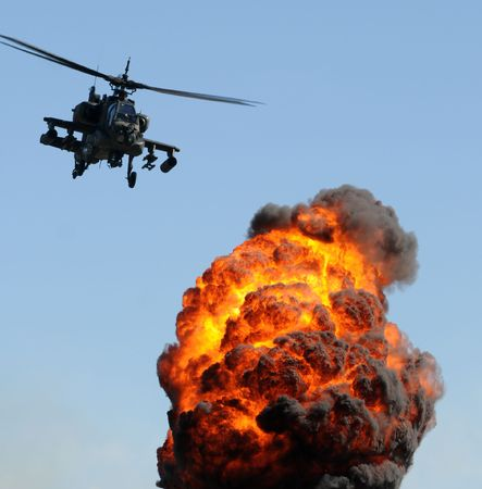 Attack helicopter delivering fire and smoke