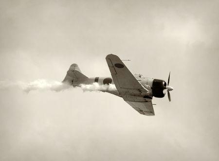 World War II era fighter airplane in a dive photo