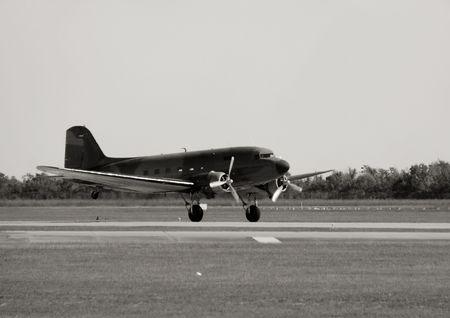 World War II era transport airplane taking off