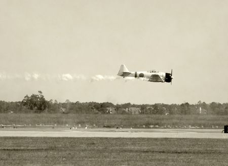 World War II era Japanese fighter airplane with smoke photo