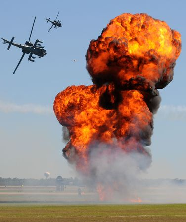 Military helicopters engaging ground targets in battle