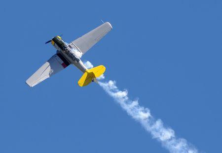 Retro propeller airplane performing stunt