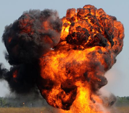 detonation: Giant outdoors explosion with fire and black smoke
