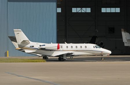 Luxury private jet in front of hangar Stock Photo - 6080068