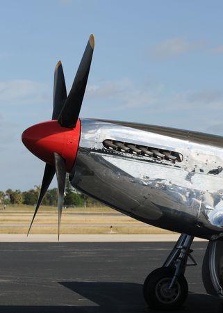 World War II era silver fighter plane Фото со стока