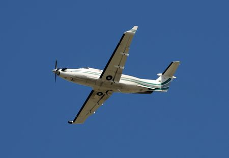 Propeller driven airplane passing overhead
