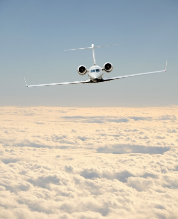 Luxury business jet in flight front view