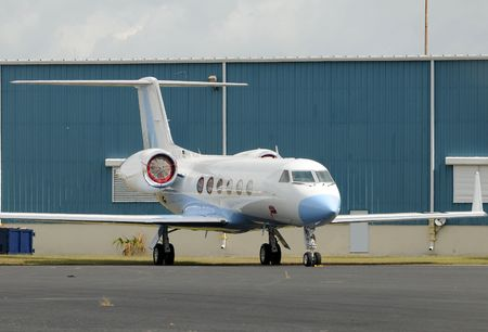 Luxury private jet parked on the ground photo