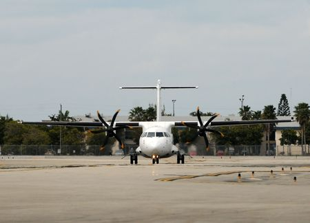 turboprop: Turboprop airplane on the ground front view Stock Photo