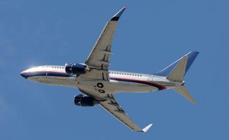 Modern passenger jet airplane taking off Stock Photo