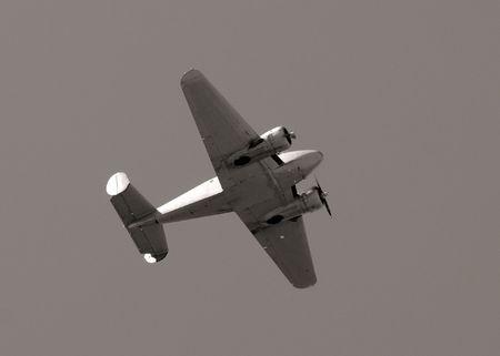 meta: Retro propeller airplane flying overhead