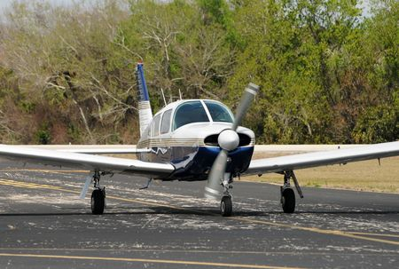 Light private propeller airplane taxiing on the ground Banco de Imagens