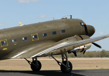 World War II era transport airplane taxiing on the ground photo